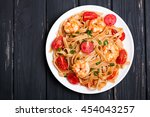pasta with shrimps and tomatoes ... | Shutterstock . vector #454043257