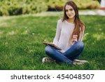 beautiful girl on the street... | Shutterstock . vector #454048507