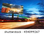 Small photo of billboard blank for outdoor advertising poster or blank billboard at night time for advertisement. street light.