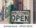 wood open sign board hang on... | Shutterstock . vector #454111813