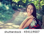 portrait of a pretty happy... | Shutterstock . vector #454119007