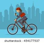cool businesswoman riding... | Shutterstock .eps vector #454177537