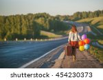 pretty girl walking with big... | Shutterstock . vector #454230373