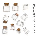 Small photo of Set of closed and opened transparent empty jars with cork bung, isolated over white