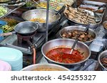 trays of various thai food in... | Shutterstock . vector #454255327
