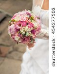 bouquet in the hands of the... | Shutterstock . vector #454277503