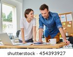 happy casual business partners... | Shutterstock . vector #454393927
