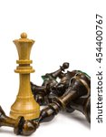 Small photo of victorious chess queen surrounded by slain pieces
