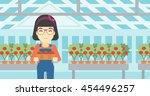 an asian female farmer holding... | Shutterstock .eps vector #454496257