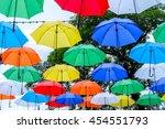 colorful umbrellas background.... | Shutterstock . vector #454551793