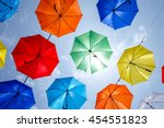 colorful umbrellas background.... | Shutterstock . vector #454551823