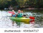 Senior Couple Kayaking On The...