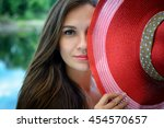 beautiful girl in a red hat... | Shutterstock . vector #454570657