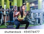 fit woman doing squat with... | Shutterstock . vector #454576477