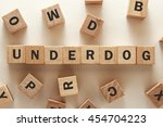Small photo of text of UNDERDOG on cubes