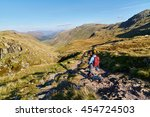 a hiker walking down towards... | Shutterstock . vector #454724503