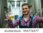 portrait of brewer holding a...   Shutterstock . vector #454776577