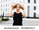 portrait of young lady with... | Shutterstock . vector #454803427