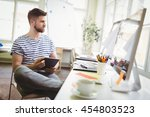 young businessman holding... | Shutterstock . vector #454803523