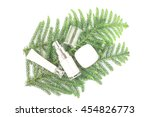 cream and pine leaves on white... | Shutterstock . vector #454826773