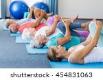 instructor performing yoga with ... | Shutterstock . vector #454831063