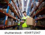 worker scanning a box in... | Shutterstock . vector #454971547