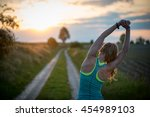 athlete woman stretching outdoor | Shutterstock . vector #454989103