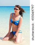 young girl in blue bikini... | Shutterstock . vector #455069797