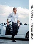 handsome man near the car....   Shutterstock . vector #455209783