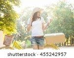 beautiful girl drinking a... | Shutterstock . vector #455242957