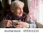 Elderly Woman Drinking Tea...