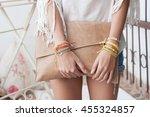 model with bracelets holding a...