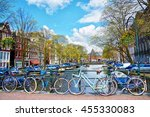 Stock photo bicycles parked on a bridge in amsterdam the netherlands 455330083