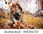 happy child playing with leaves ... | Shutterstock . vector #455351737