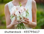 wedding flowers  woman holding... | Shutterstock . vector #455795617