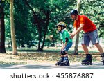 father teching son roller... | Shutterstock . vector #455876887
