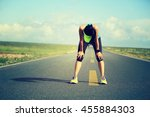 tired woman runner taking a... | Shutterstock . vector #455884303