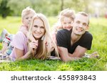family playing in the park on... | Shutterstock . vector #455893843
