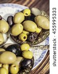 Small photo of Bowl filled with fresh black olives served as an accompaniment or appetizing snack
