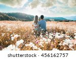 young couple sitting on the... | Shutterstock . vector #456162757