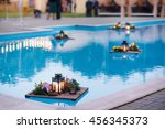 the glowing candles on the pool | Shutterstock . vector #456345373