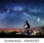 cyclist riding bike on the top... | Shutterstock . vector #456355207