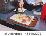 male cook serve delicious steak ... | Shutterstock . vector #456403273