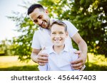 father and son having fun in... | Shutterstock . vector #456447403