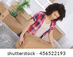 young girl arranging interior... | Shutterstock . vector #456522193
