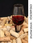Small photo of A glass of red wine in a rustic ambience
