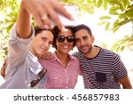 three friends posing for a... | Shutterstock . vector #456857983