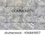 Small photo of Community Concept - Community sign on ageless marble wall - with copy space
