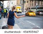 girl calling hailking taxi cab...   Shutterstock . vector #456905467