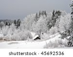 Snowy Trees Behind Old Country...